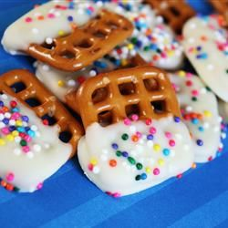 White Chocolate Covered Pretzels - add 1 Tbsp shortening to melted chocolate to prevent clumping - add crushed candy cane