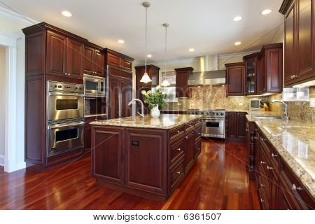 Cherry Wood kitchens are so beautiful!!! I don't even cook, but I would totally cook in a kitchen like this!