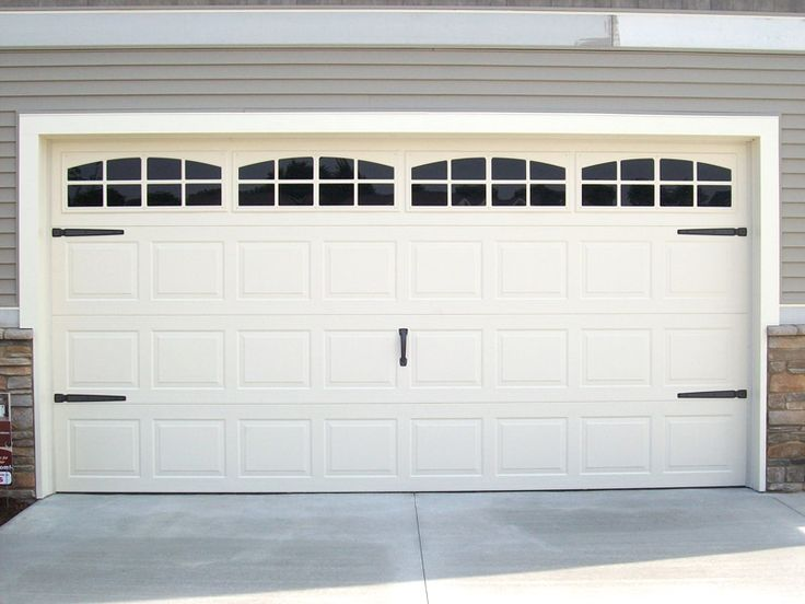 Carriage House door hardware and faux windows to dress up plain garage doors. By Coach House Accents