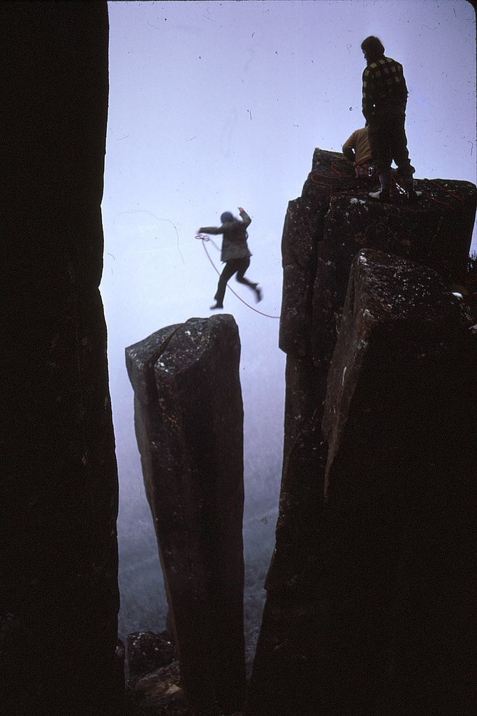 One Day on the Organ Pipes    : :     Lyle Closs jumps to Albert's Tomb, Organ Pipes Mt Wellington Tasmania (1974 Photo S. Karpiniec)