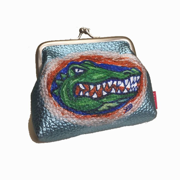 Part of my game day college football custom line . Great for the stylish gator fan, university of Florida alumni and the orange and blue gator nation. Not your favorite team? Hand painted custom purses can show any team spirit, check it out.