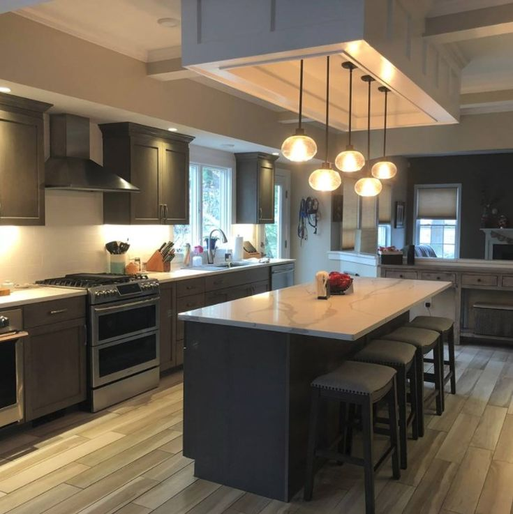 Check out this stunning kitchen remodel by Adrienne Amore of Kitchens By Design Inc. in Johnston, Rhode Island! The new contemporary look features UltraCraft Cabinetry's frameless cabinets in Cherry with Coastal Grey stain.  #kitchenremodel #remodel #redesign #brandnewkitchen #cherrywood #cherrycabinets #ultracraft #ultracraftcabinetry #kitchensbydesign