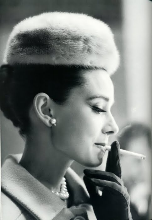 Audrey Hepburn, fur pillbox hat and pearls.