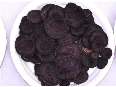 Pusa Asita Black Carrot. Super high in antioxidants. Would add some interest when tossed in dishes with yellow or orange carrots. Or grated up and tossed into chili.