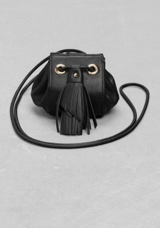 This adorable leather pouch features a feathery tassle and a long drawstring handle that allows the pouch to be carried cross-body, for a boho-chic comfort.