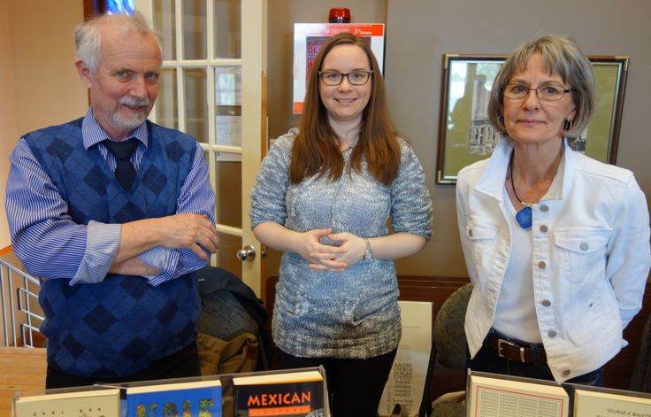 Tim Inkster, Stephanie Small and Elke Inkster behind the PQL book table at the Grimsby Wayzgoose, April 30, 2016. Photo by Don McLeod.