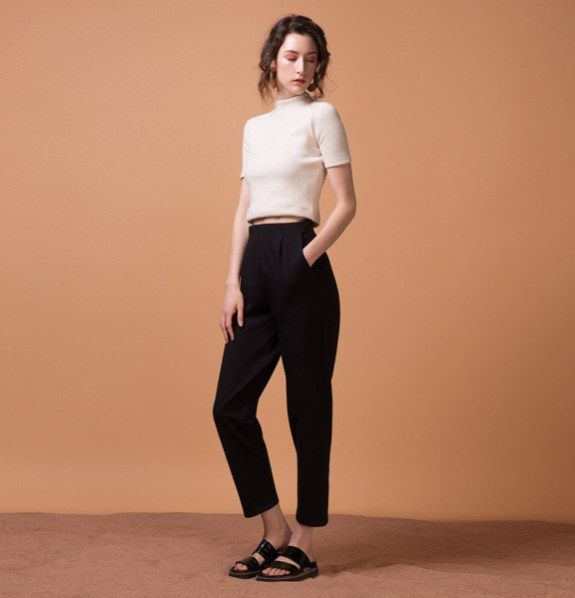 The DIPLOMATE is finally available in black!  With its pleated high waist and super stretchy fabric, this pant will offer you both structure and comfort.  We believe it's a must-have pant as we chose a specifically stretchy french terry fabric that will follow all your movements.  Slightly loose fit that pairs so well with any of our crop tops too!    Model is 5'8″/173 cm and is wearing size XS  94% cotton/ 6% spandex  Designed and made in Montreal.