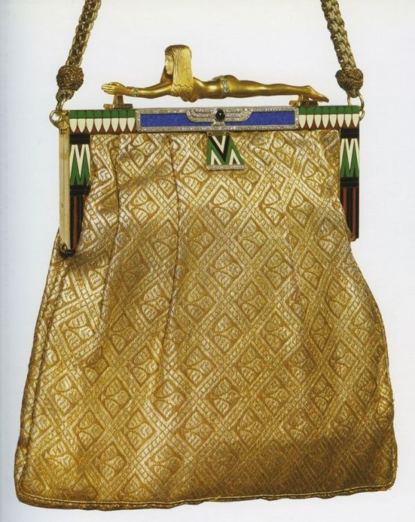 Art Deco Egyptian Revival evening bag, circa 1925, 18K gold, diamonds, onyx, emeralds, silk, and enamel.