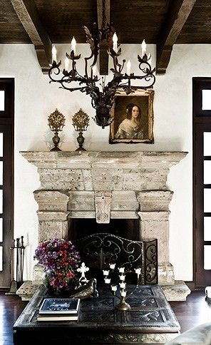 Beautifully rustic fireplace vignette - Exposed wood ceiling - Stone fireplace mantle - Neutral color palette