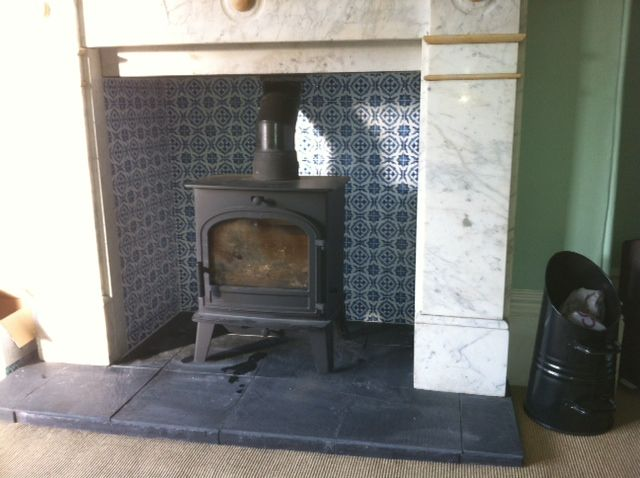 Blue patterned tile back plus slate hearth barns Fired tiles