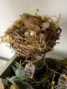 Nest on vintage bedspring...