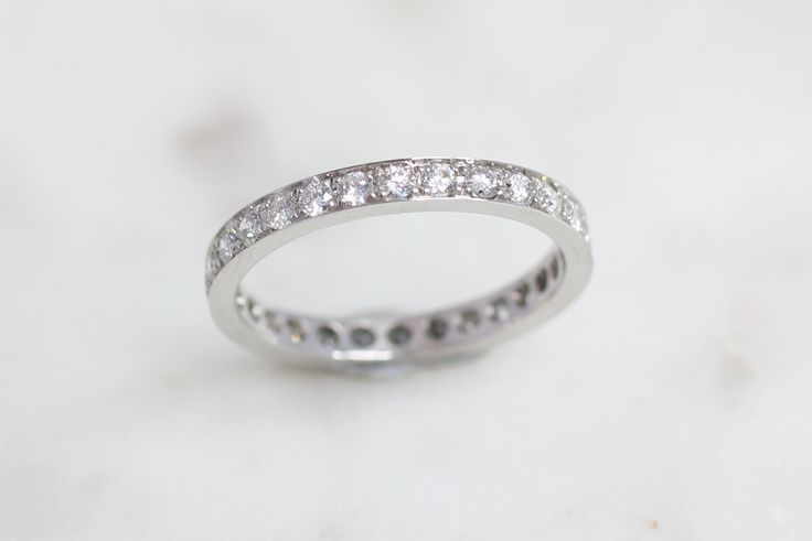 The most classic wedding ring with diamonds all the way around.