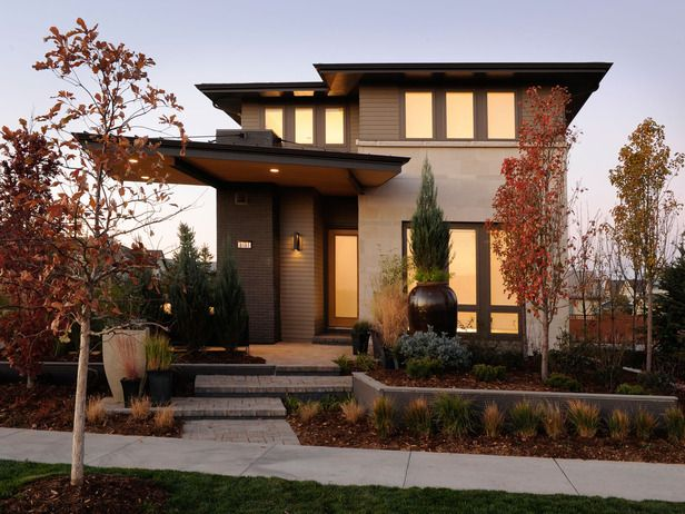 Green Home 2011 in Denver  The architecture of this eco-friendly home is inspired by the Prairie School style espoused by early 20th-century architects like Frank Lloyd Wright. Flat roofs, wide overhanging eaves, locally sourced mater… more