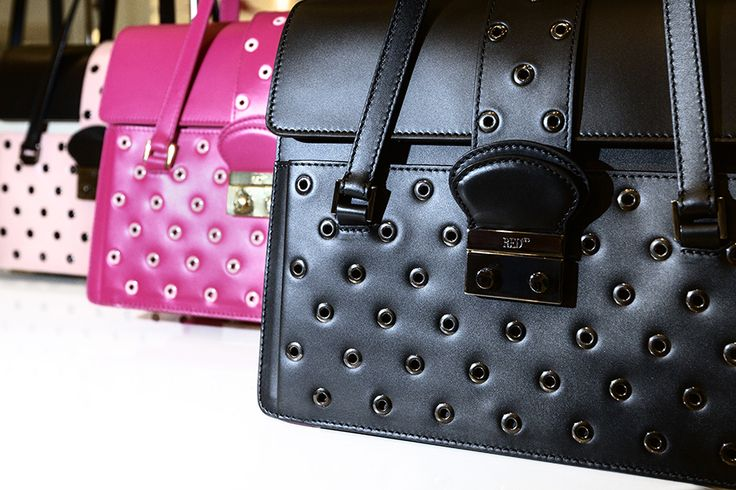 Handbags with small grommets! On www.redvalentino.com