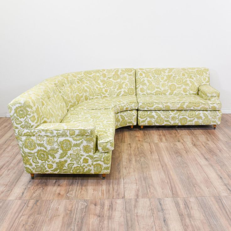 This floral sectional sofa is upholstered in a yellow and green floral pattern. This couch is in great condition with three rearrangeable seats, squab cushions, and square, tapered feet. A great piece for a funky living room! #eclectic #sofas #sofaorcouch #sandiegovintage #vintagefurniture