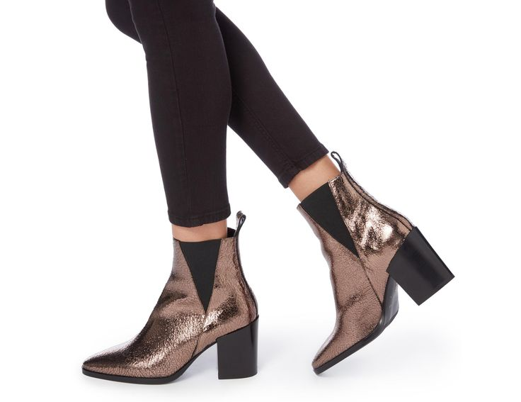 Update your everyday staple wardrobe with this chic V cut Chelsea boot. It features a classic pointed toe, pull up tab and high block heel. Team it with a sweater dress for a chic and understated outfit.