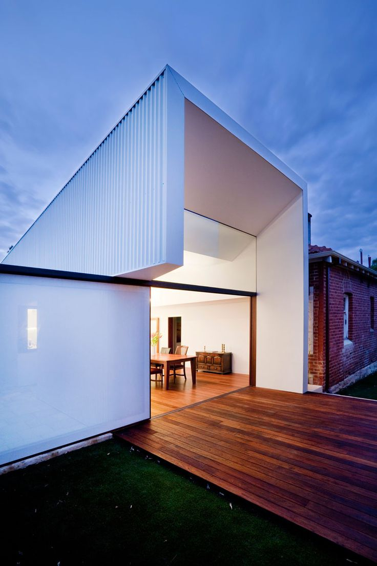 To the North a sliding door and clerestory window open to the light and the deck at Westbury Crescent Residence