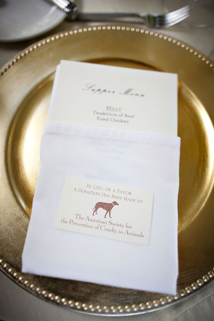 Small card at place setting with donation to Lollypop Farm in lieu of favor...of course with a dachshund image.  I saw another pin that included a paw print chocolate candy with it which was also cool