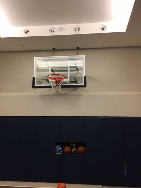 Newly installed First Team SuperMount46 Pro wall mounted basketball system.