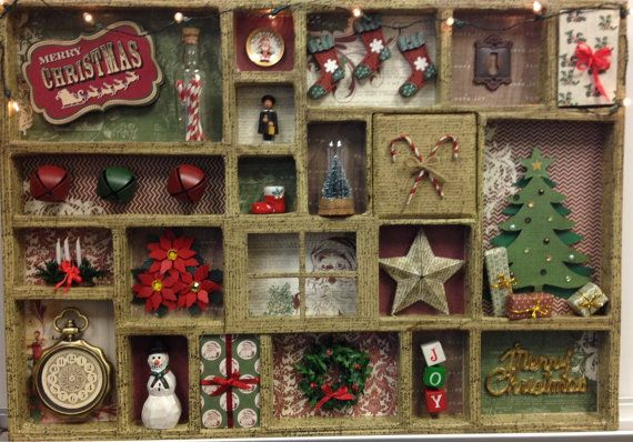 This is a printer tray/shadow box made from Tim Holtz Configurations. I used My Minds Eye Vintage Christmas paper and script washi tape. The