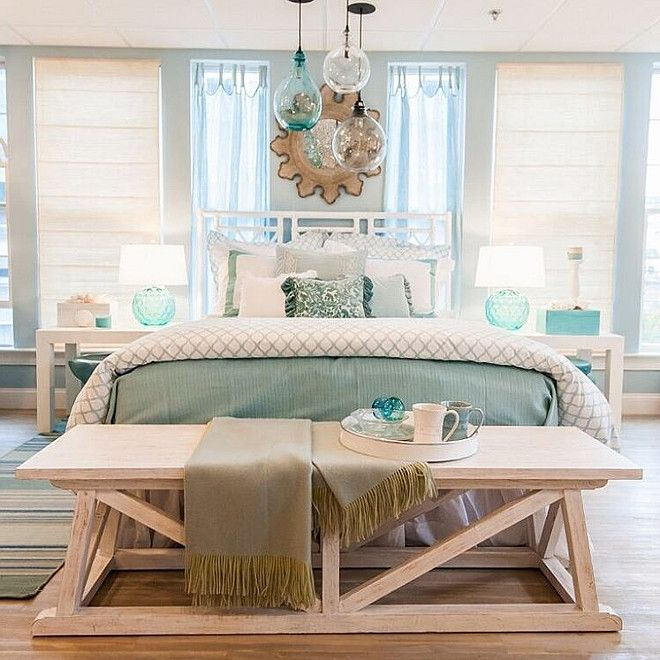 Coastal Beach House Bedroom With Sea Inspired Accents And Aqua Hues.