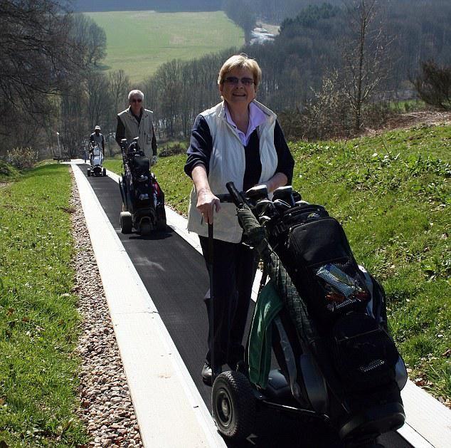 Travelator Transporting Golfers