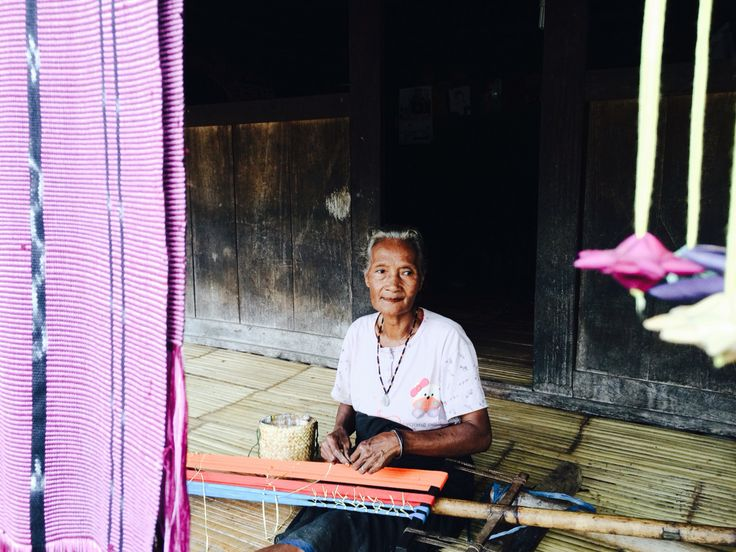 Ikat tenun is in the making by an old lady of Bena village, Bajawa Flores