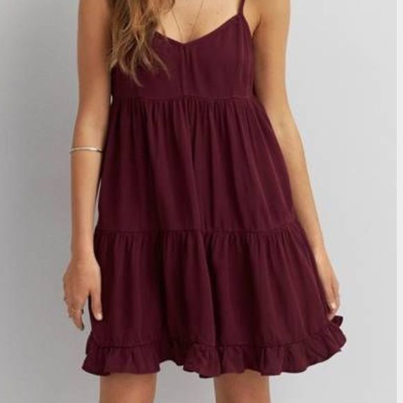 Maroon Baby Doll Dress Super adorable dress. I've only worn it a few times.The back is slightly open(looks super cute with a bandeau). It's a large but it's super short! So probably more like a small or medium(: Dresses
