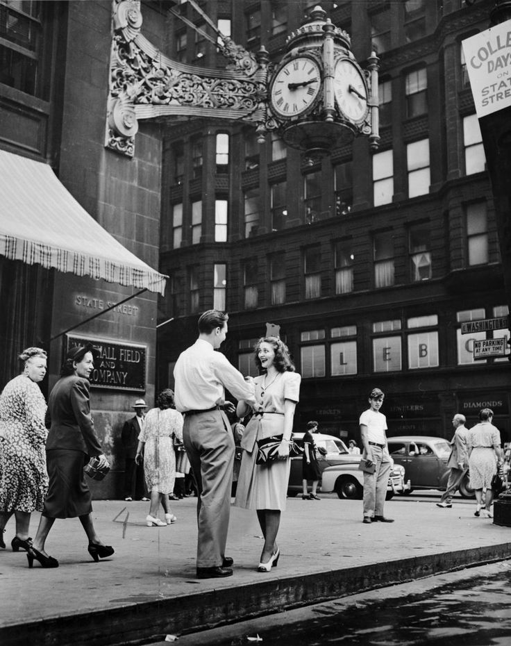 Boy meets girl under the Marshall Field's clock on State Street, September 20, 1947. Photograph from the Chicago Daily News.