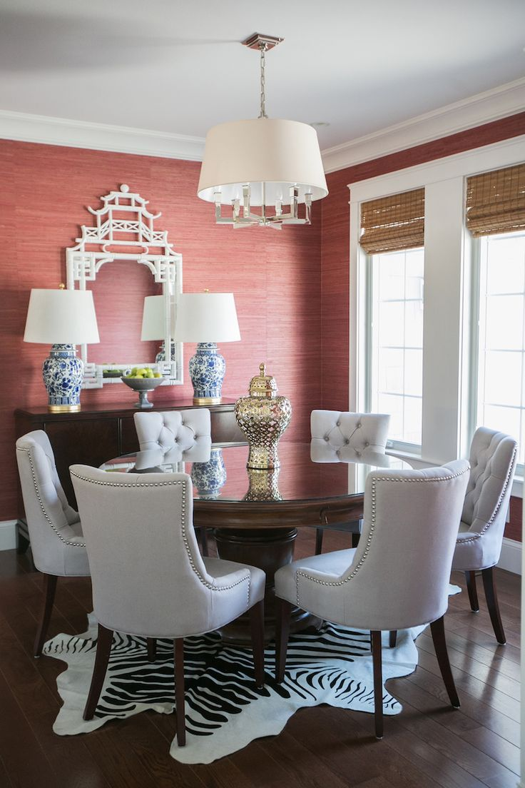 dining room coral grasscloth wallpaper pagoda mirror blue and white zebra rug