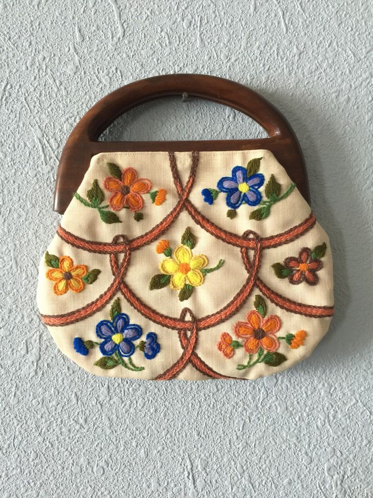 1970's Floral Embroidered Hippie Handbag by Ohluluvintage on Etsy https://www.etsy.com/listing/270572667/1970s-floral-embroidered-hippie-handbag
