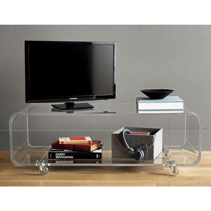 Shop peekaboo acrylic media console.   New transparent media console floats in the room without taking up permanent visual residency.  Thick-cut plexi in one seamless turn adds clean mod edge to flatscreen display with a lower shelf for electronics.