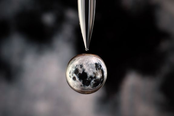 Little Moon...the moon gets the water drop treatment in this photograph by Markus Reugels