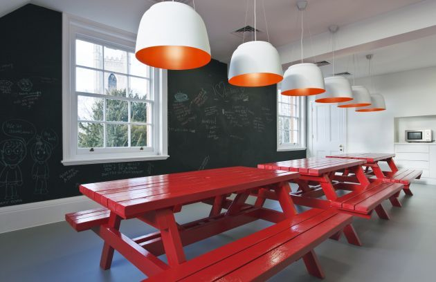 Quirky staff canteen - chalkboard wall, red painted picnic benches, statement lighting. Langland Office Interior by Jump Studios » CONTEMPORIST