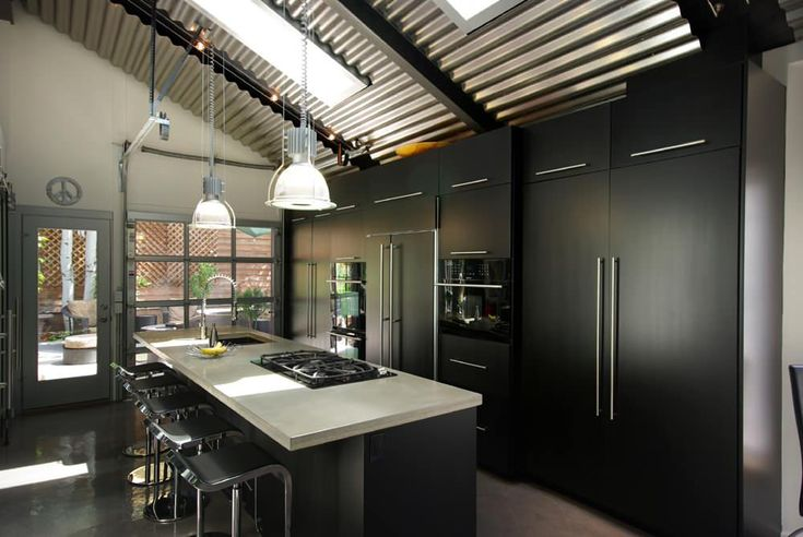 slopped ceiling flat panel cabinet black cabinet black appliances black island light countertop stainles steel bar stool ceiling lights of Irresistible Kitchen with Black Appliances Ideas