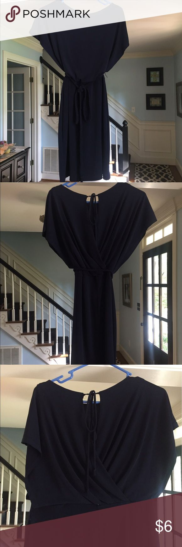Navy short dress Cute Navy dress. Short with cute tie in back. Braided belt around waste-line. There are little loops (thread) for belt however they are broken. Not needed for wearing braided belt. enfocus Dresses Mini