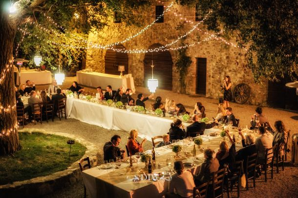 Strings of light and soft uplighting create a warm and magical dinner party atmosphere