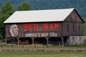 red man ad on barn