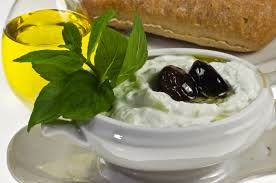 TZATZIKI is a kind of salad with yoghurt, cucumber and lots of garlic.