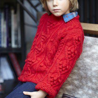 Un pull rouge pour enfant à nopes et torsades - Marie Claire Idées