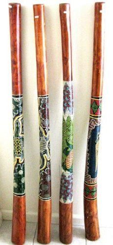 """Didgeridoo Percussion Musical Instrument - Handpainted Teak Wood- 52"""" by World Bazaar Imports. $69.99. Handcarved from teak wood and then embellished with traditional painted designs, these woodwind instruments are the world's oldest wind instrument, origins going back as 40,000 years. The didgeridoo (also known as didjeridu or didge) is a traditional wind instrument of the Aborigines.  Handcrafted in Indonesia, these beautiful didgeridoos are pieces of art and music.  We carry..."""