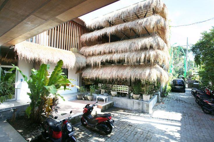 alexis dornier crafts vegan restaurant in bali with grass + bamboo exterior