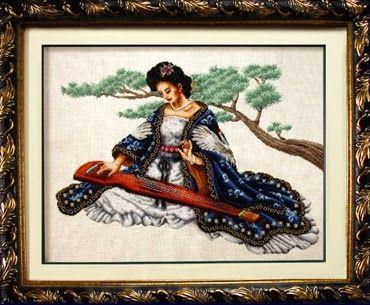 Precioso gráfico estilo oriental con una dama tocando el sitar...