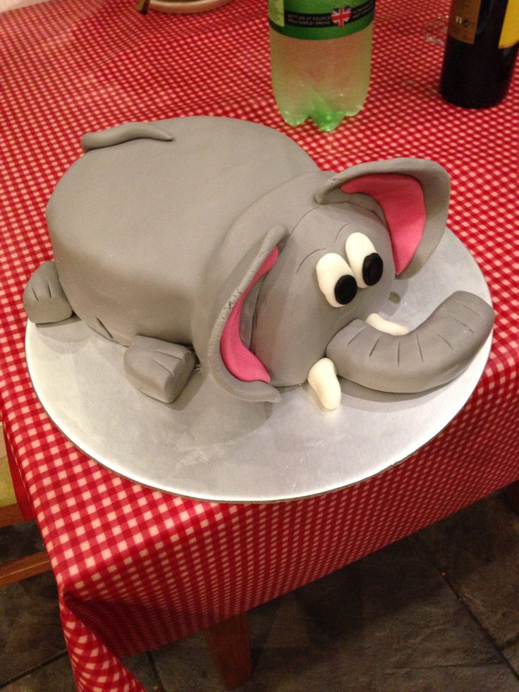 "Elephant cake for toddler birthday party. Chocolate cake body 8"" and vanilla head 6"" bowl cake with a 1/4 cake sliced off to make a flat base for the head. Crumbed in marshmallow buttercream and grey fondant."