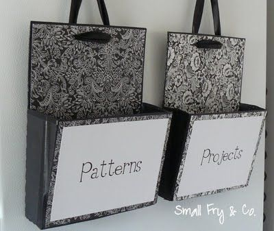 Hanging file folders from repurposed boxes...the kind you get from Sams to take you groceries home in..pretty!