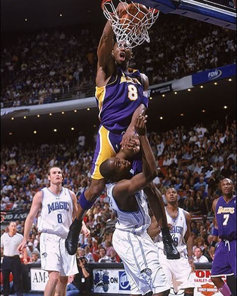 Kobe Bryant dunks on Dwight Howard