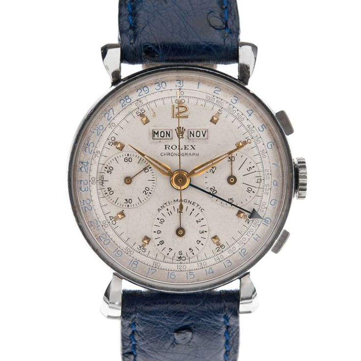 Rolex ref #4768, circa 1947. Fine and rare. Stainless steel and gold triple calendar chronograph wristwatch