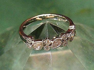 Jewellery-Ring-Designer-18 carat white gold milgrain tear drop diamond band