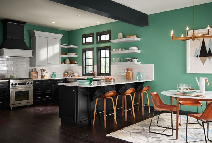 These Are The Colors Everyone Will Be Talking About In 2017: BLUE-GREEN   Orange accents pack a punch in a saturated green space. It's the perfect color combo for when you want to up the drama. Get the look: Jade Dragon by Behr   colours, trends, home, styling, interior, decoration