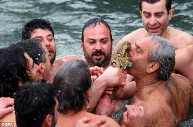 orthodox faithful   Epiphany Around the World: Orthodox Believers Dive For Crucifix (PHOTO ...